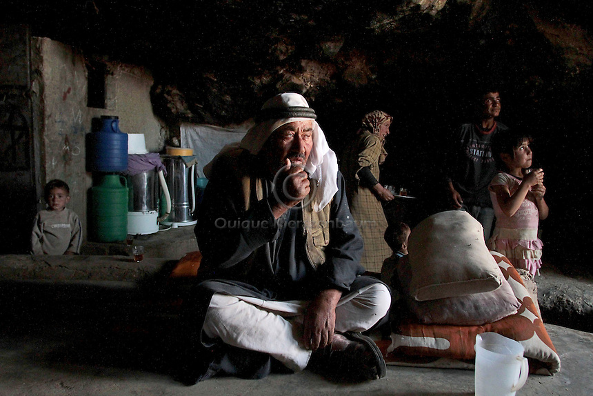 "Hamid Jabareen and his family are seen in his cave in Jenba a Palestinian town of 50 families seats in an area called by the IDF as ""Firing Zone 918"" and is located in the southern Hebron hills near the town of Yatta.  Spread over 30,000 dunams, it includes twelve Palestinian villages.  According to OCHA figures, 1,622 people lived in the area in 2010, and according to local residents the number of inhabitants currently stands at about 1,800. For over a decade, the residents of twelve uniquely traditional Palestinian villages in the area of Masafer-Yatta in the south Hebron hills have lived under the constant threat of demolition, evacuation, and dispossession.<br />