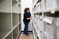 NWA Democrat-Gazette/CHARLIE KAIJO Tiffany Underwood, office manager, puts away boxes of old probate cases, marriage licenses and voter records going back to late 1800s, Friday, March 16, 2018 at the new Benton County Clerk's office in Rogers. <br /><br />The Benton County Clerk moved their Rogers staff and operation to the new space in the old Kmart building at 2109 W. Walnut St. in Rogers