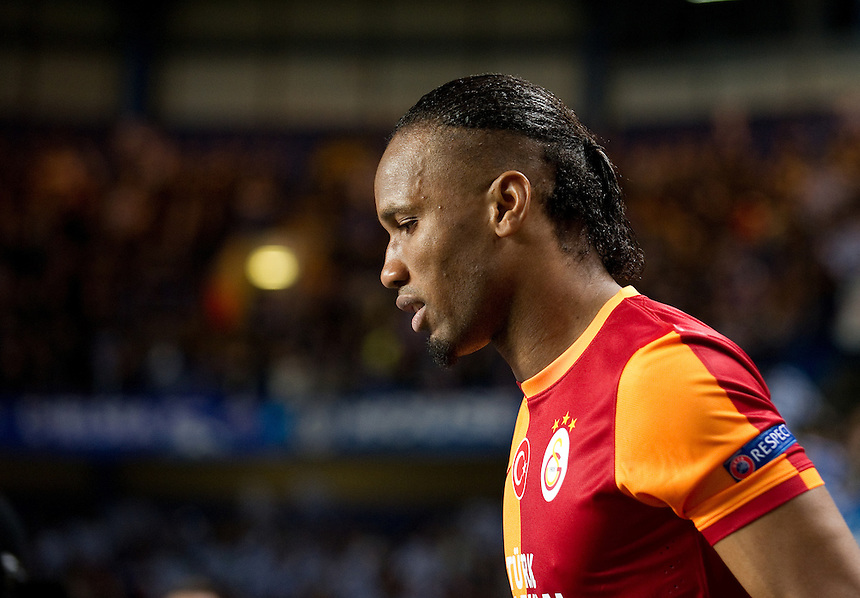 Galatasaray's Didier Drogba comes out onto the pitch at Stamford Bridge<br /> <br /> Photo by Ashley Western/CameraSport<br /> <br /> Football - UEFA Champions League First Knockout Round 2nd Leg - Chelsea v Galatasaray - Tuesday 18th March 2014 - Stamford Bridge - London<br />  <br /> &copy; CameraSport - 43 Linden Ave. Countesthorpe. Leicester. England. LE8 5PG - Tel: +44 (0) 116 277 4147 - admin@camerasport.com - www.camerasport.com