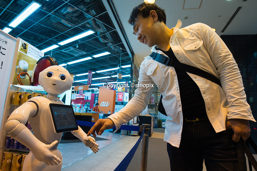 SloftBank's first robot, Pepper greeting customers at LABI Electric shop in Shibuya, Tokyo