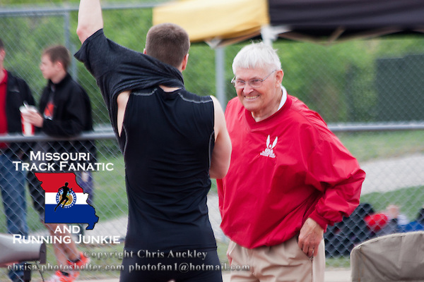 Official and coach Dr. Wayne Armbrust visits with high jumper Andy Gilmore after the  high jump at the 2012 Missouri Relays.