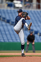 Cal State Fullerton Titans pitcher John Gavin (44) delivers a pitch during a game against the Louisville Cardinals on February 15, 2015 at Bright House Field in Clearwater, Florida.  Cal State Fullerton defeated Louisville 8-6.  (Mike Janes/Four Seam Images)