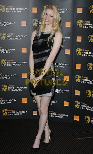 TALULAH RILEY  .The nominations for The Orange British Academy Film Awards (BAFTAs) at BAFTA headquarters, London, England..January 18th, 2011.full length black grey gray dress sleeveless.CAP/CAN.©Can Nguyen/Capital Pictures.