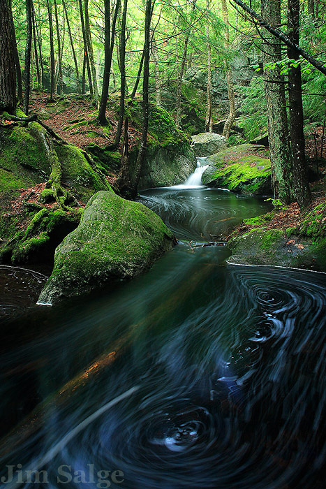 Pulpit Rock in Bedford, NH is a glacial relic, a giant pothole in a tiny stream carved into the bedrock by the flood of an ancient lake.  Below this interesting geologic feature, the brook takes on the character of a beautiful forest stream.  A long exposure accentuated the eddies in the water and the spring green in the trees.