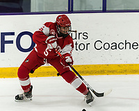 WORCESTER, MA - FEBRUARY 08: Courtney Correia #5 of Boston University centers the puck during a game between Boston University and College of the Holy Cross at Hart Center Rink on February 08, 2020 in Worcester, Massachusetts.