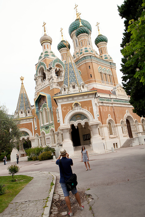 Visitors photograph the Russian Orthodox Cathedral, Nice, France, 28 April 2012