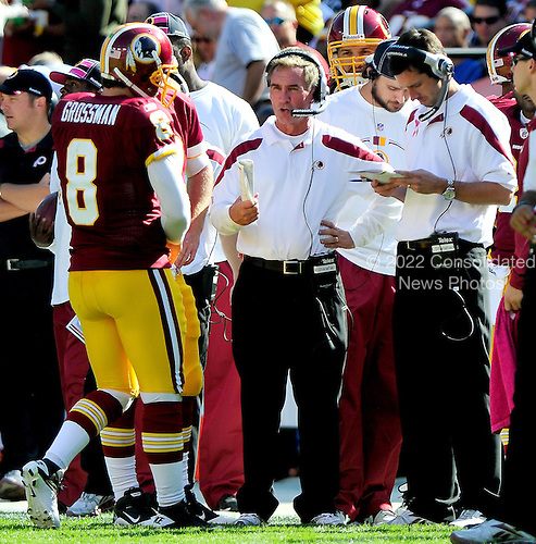 Washington Redskins quarterback Rex Grossman (8) discusses strategy during a time-out with head coach Mike Shanahan, center, and offensive coordinator Kyle Shanahan, right, in the second quarter against the Philadelphia Eagles at FedEx Field in Landover, Maryland on Sunday, October 16, 2011..Credit: Ron Sachs / CNP