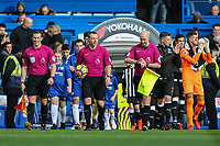 Referee Mr Kevin Friend (Centre) leads out the teams ahead of the Premier League match between Chelsea and Newcastle United at Stamford Bridge, London, England on 2 December 2017. Photo by David Horn.
