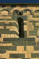 Corsica. Eglise St. Michel at Murato in the Nebbio. 1140 - 1280. France.  Window with snakes, birds and cabbalistic symbols carved on the lintels..