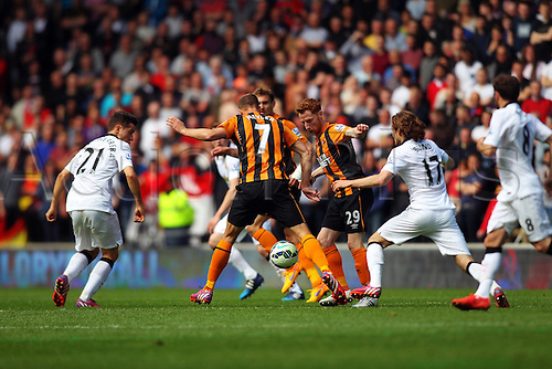 24.05.2015.  Hull, England. Barclays Premier League. Hull versus Manchester United. David Meyler of Hull City Stephen Quinn of Hull City and Daley Blind of Manchester United challenges for the ball