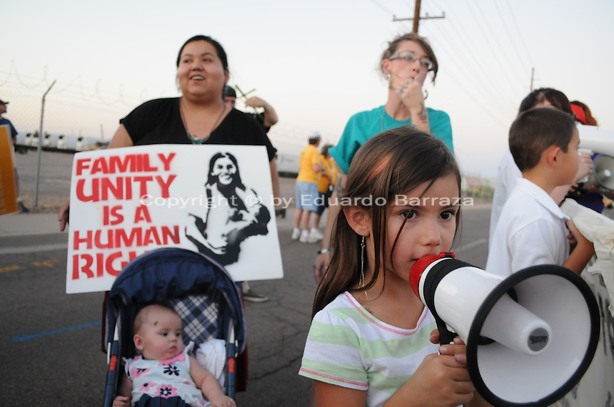 "Phoenix, Arizona. June 23, 2012 - Members of the Unitarian Universalist church and community advocates gathered outside the Tent City Jail in Arizona to demand  Sheriff Joe Arpaio to shut down what they call a ""concentration camp"" and inhumane outdoor jail facility. Tent City houses inmates in canvas tents and during the summer the temperature raises significantly under the tents. In this image,  a four-year old girl uses a bullhorn to demonstrate against Sheriff Joe Arpaio during the protest to demand the closure of the Tent City Jail. Photo by Eduardo Barraza © 2012"
