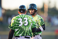 Eugene Emeralds right fielder Jonathan Sierra (22) talks to first base coach Osmin Melendez (33) during a Northwest League game against the Salem-Keizer Volcanoes at Volcanoes Stadium on August 31, 2018 in Keizer, Oregon. The Eugene Emeralds defeated the Salem-Keizer Volcanoes by a score of 7-3. (Zachary Lucy/Four Seam Images)