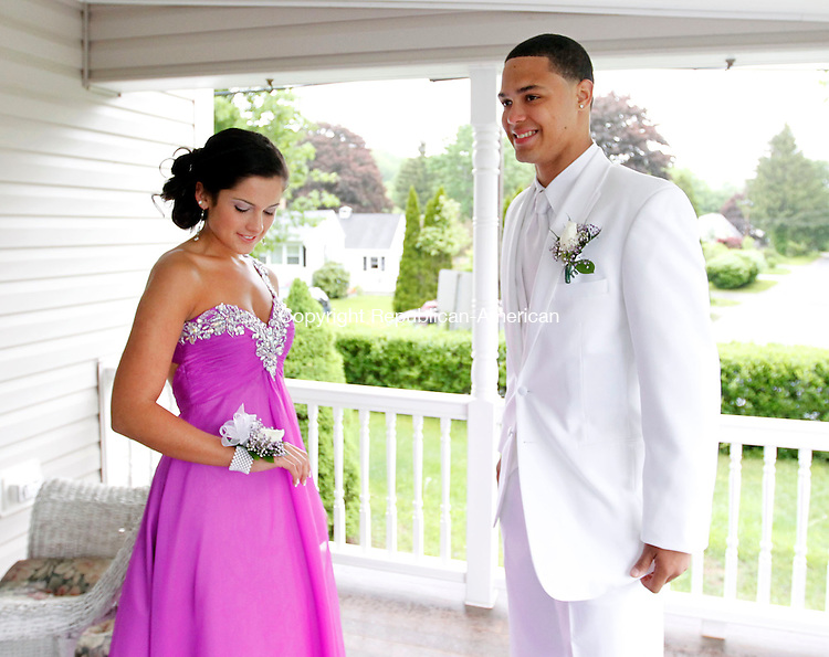 Winsted, CT- 24 May 2013-052413CM11-  Victor Diaz and his prom date, Allie Reardon take a moment at a relative of Reardon's house on Highland Lake in Winsted Friday night.  The couple attended the prom, which was held in Hartford at the Society Room.     Christopher Massa Republican-American
