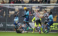 Adebayo Akinfenwa of Wycombe Wanderers takes a shot at goal during the Sky Bet League 2 match between Notts County and Wycombe Wanderers at Meadow Lane, Nottingham, England on 10 December 2016. Photo by Andy Rowland.