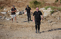 Pictured: DI Jon Cousins of South Yorkshire Police (R) during the preliminary search at the new site in Kos, Greece. Friday 07 October 2016<br /> Re: Police teams led by South Yorkshire Police, searching for missing toddler Ben Needham on the Greek island of Kos have moved to a new area in the field they are searching.<br /> Ben, from Sheffield, was 21 months old when he disappeared on 24 July 1991 during a family holiday.<br /> Digging has begun at a new site after a fresh line of inquiry suggested he could have been crushed by a digger.