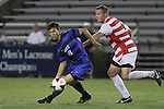 30 August 2013: Duke's Brody Huitema (CAN) (19) and Rutger's Joe Setchell (ENG) (right). The Duke University Blue Devils hosted the Rutgers University Scarlet Knights at Koskinen Stadium in Durham, NC in a 2013 NCAA Division I Men's Soccer match. The game ended in a 1-1 tie after two overtimes.