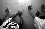 tohajiilee1/1-14-03/jp3/asec.  Members of the To'Hajiilee varsity boys basketball team, stretch in the locker room shortly before playing Corona H.S. at To'Haliilee, Thursday Jan. 16, 2003.   (Pat Vasquez-Cunningham/Journal)