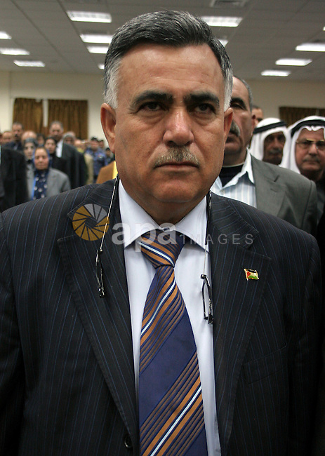 A Chief of the general personnel council, Hussein al-Arja is honored by Palestinians in the building of Hebron governorate in the West Bank city of Hebron on May 3,2010. Photo by Najeh Hashlamoun