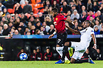 Fred Rodrigues of Manchester United (L) is challenged by Geoffrey Kondogbia of Valencia CF (R) during the UEFA Champions League 2018-19 match between Valencia CF and Manchester United at Estadio de Mestalla on December 12 2018 in Valencia, Spain. Photo by Maria Jose Segovia Carmona / Power Sport Images
