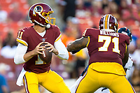 Landover, MD - August 24, 2018: Washington Redskins quarterback Alex Smith (11) drops back in the pocket during preseason game between the Denver Broncos and Washington Redskins at FedEx Field in Landover, MD. The Broncos defeat the Redskins 29-17. (Photo by Phillip Peters/Media Images International)