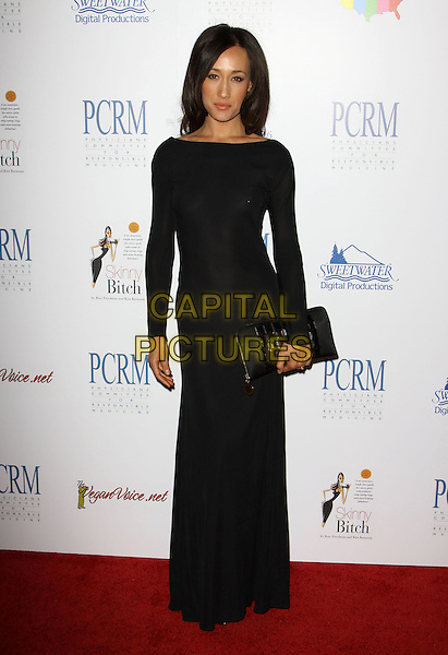 MAGGIE Q.The Art of Compassion PCRM 25th Anniversary Gala held At The Lot Studios, West Hollywood, California, USA, 10th April 2010..full length black dress long maxi sleeved clutch bag sleeves .CAP/ADM/KB.©Kevan Brooks/AdMedia/Capital Pictures.