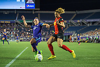 Orlando, Florida - Sunday, May 14, 2016: Western New York Flash forward Lynn Williams (9) looks to cross the ball before Orlando Pride forward Josee Belanger (9) can make a challenge during a National Women's Soccer League match between Orlando Pride and New York Flash at Camping World Stadium.