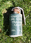 Discarded used smoke screen hand grenade canister container close up, military training area, Salisbury Plain, Wiltshire, England, UK