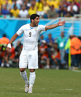 Luis Suarez of Uruguay gestures in frustration toward the Italy bench as he believes they are time wasting