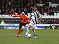 Dougie Imrie watched by Willo Flood in the St Mirren v Dundee United Clydesdale Bank Scottish Premier League match played at St Mirren Park, Paisley on 27.10.12.
