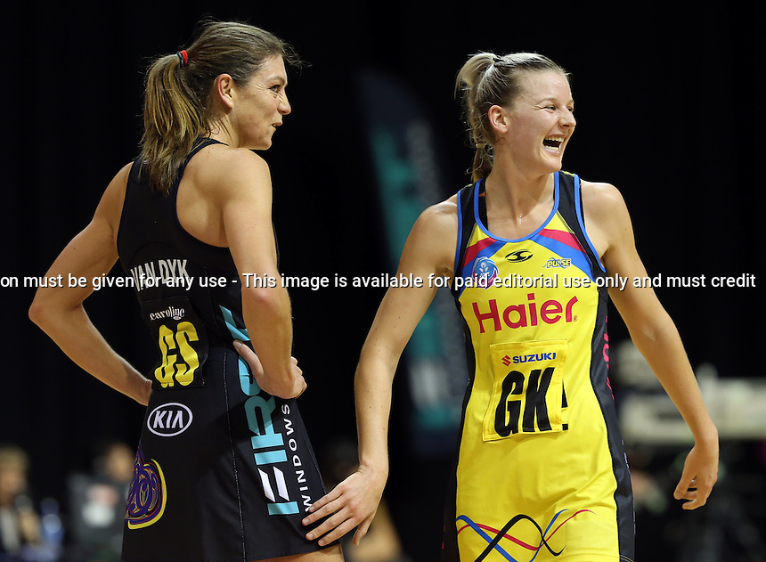13.05.2013 Magic's Irene Van Dyk and Pulse's Katrina Grant in action during the ANZ Champs netball match between the Magic and Pulse played at Claudelands Arena in Hamilton. Mandatory Photo Credit ©Michael Bradley.