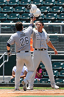 5 June 2010:  FIU's Yoandy Barroso (38) and Tim Jobe (26) celebrate after Jobe hit a two-run home run in the second inning as the Dartmouth Green Wave defeated the FIU Golden Panthers, 15-9, in Game 3 of the 2010 NCAA Coral Gables Regional at Alex Rodriguez Park in Coral Gables, Florida.