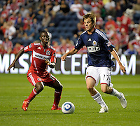 Chivas forward Justin Braun (17) attempts to maneuver around Chicago midfielder Patrick Nyarko (14).  The Chicago Fire tied Chivas USA 1-1 at Toyota Park in Bridgeview, IL on May 1, 2010.