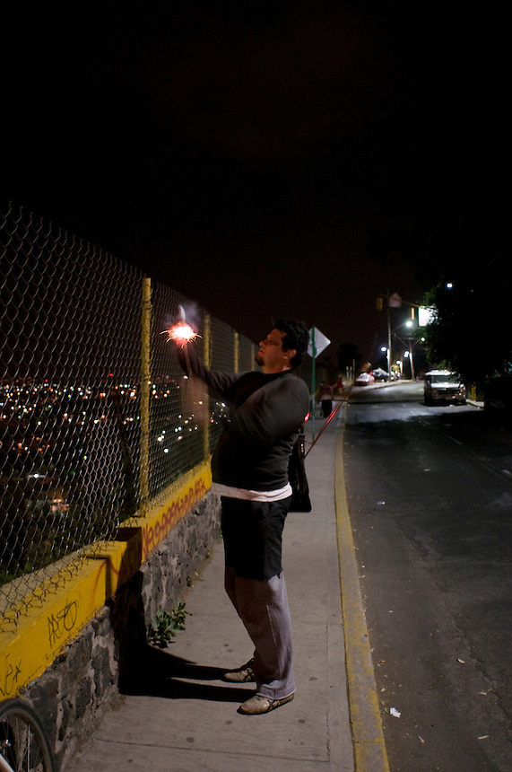 Luis lights a firework/rocket over the city. Calle Antigua Vill a la Venta. Bike rides around Mexico City at night with Luis Mdahuar, Mike Smith, and Kurt Hollander (during the swine flu pandemic).  Mexico DF May 6, 2009