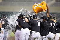 The Kannapolis Intimidators celebrate their walk-off win over the Lakewood BlueClaws at Kannapolis Intimidators Stadium on July 7, 2018 in Kannapolis, North Carolina. The Intimidators defeated the BlueClaws 4-3 in 10 innings.  (Brian Westerholt/Four Seam Images)