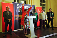 Pictured: Labour candidate for Swansea East constituency Carolyn Harris (2nd L) celebrates her win after it was announced.  Friday 09 June 2017<br />Re: Counting of ballots at Brangwyn Hall for the general election in Swansea, Wales, UK