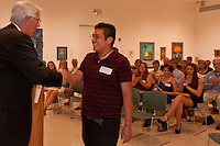 Oscar Santiago accepts his scholarship during the Naples Art Associations 40th Annual Jade N. Riedel Scholarship Competition at The von Liebig Art Center, Naples, Florida, April 15, 2011. Photo by Debi PIttman Wilkey