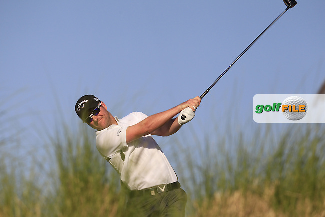 Marc WARREN (SCO) tees off the 9th tee during Thursday's Round 2 of the 2015 Commercial Bank Qatar Masters held at Doha Golf Club, Doha, Qatar.: Picture Eoin Clarke, www.golffile.ie: 1/22/2015