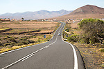 Tarmac road crossing countryside, Fuerteventura, Canary Islands, Spain