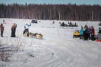 Jessie Royer runs on Long Lake past picnicing spectators during the Restart of the 2016 Iditarod in Willow, Alaska.  March 06, 2016.