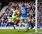 Hearts keeper Jack Hamilton scrambles the ball away from the awaiting Alfredo Morelos