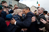 President Barack Obama and First Lady Michelle Obama greet people on Main Street in Moneygall, Ireland, May 23, 2011. .Mandatory Credit: Pete Souza - White House via CNP