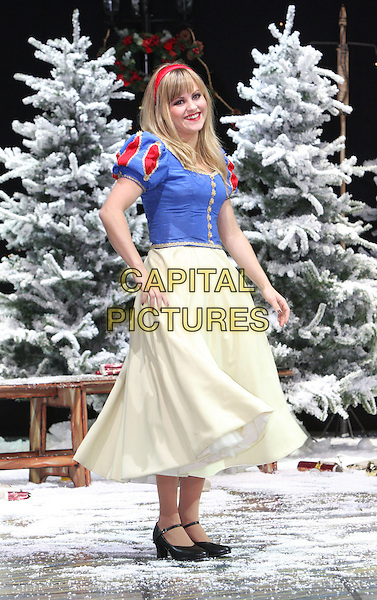 TINA O'BRIEN .First Family Entertainment 2011 Pantomimes Photocall at the Piccadilly Theatre, London, November 26th 2010..panto costume full length snow white dress blue yellow red .CAP/JIL.©Jill Mayhew/Capital Pictures