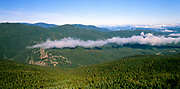 Early morning haze surrounds the Willey Range from Mount Jackson in the White Mountain National Forest of New Hampshire.