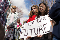 NWA Democrat-Gazette/CHARLIE KAIJO Annika Beach, 10, of Brightfield Middle School (right) demonstrates during the &quot;March For Our Lives&quot; rally, Saturday, March 24, 2018 at the Bentonville Square in Bentonville. <br /> <br /> &ldquo;March For Our Lives&rdquo; is a march against gun violence. &quot;[We're] just a group of kids who got together one day and wanted to make a change,&quot; said Taylor Gibson, 16, a student at Bentonville West High School. She is one of nine students from area high schools including Bentonville West, Bentonville High, Gravette and Haas Hall who organized the rally. The rally is in solidarity with more than 800 protests around the world according to &quot;March For Our Lives&quot; organizers