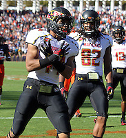 Maryland Terrapins running back Justus Pickett (44) celebrates a touchdown during the game against Virginia in Charlottesville, Va. Maryland defeated Virginia 27-20.