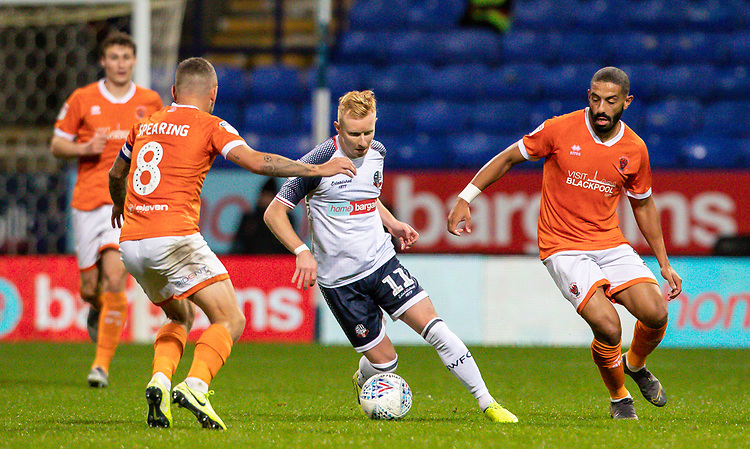 Bolton Wanderers' Ali Crawford (centre) competing with Blackpool's Jay Spearing (left) and Liam Feeney <br /> <br /> Photographer Andrew Kearns/CameraSport<br /> <br /> The EFL Sky Bet League One - Bolton Wanderers v Blackpool - Monday 7th October 2019 - University of Bolton Stadium - Bolton<br /> <br /> World Copyright © 2019 CameraSport. All rights reserved. 43 Linden Ave. Countesthorpe. Leicester. England. LE8 5PG - Tel: +44 (0) 116 277 4147 - admin@camerasport.com - www.camerasport.com