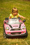 Toddler in electric play car.