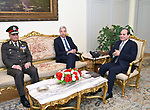 This handout picture released by the Egyptian Presidency on April 14, 2019, shows Egyptian president Abdel Fattah al-Sisi (R) meeting Portugal Defense Minister Joao Gomes Cravinho (C) at the Ittihadia presidential Palace in the capital Cairo. Photo by Egyptian President Office