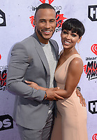 Megan Good + DeVon Franklin @ the 2016 iHeart Radio Music awards held @ the Forum.<br /> April 3, 2016