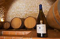 Cuvee Sainte Agnes. Domaine Ermitage du Pic St Loup, Chateau Ste Agnes. Pic St Loup. Languedoc. Barrel cellar. France. Europe. Bottle.